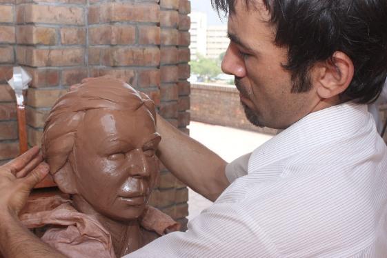 Artist Imran Hunzai at work.
