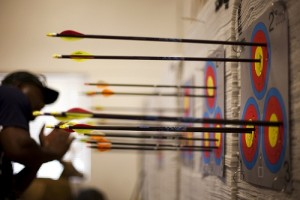 The Marine Corps' Warrior Games archery coach inspects the targets after a round of shooting during practice for the 2012 Warrior Games at Colorado Springs, Colo., April 25, 2012. The Warrior Games is a competition between wounded warriors from all military branches and includes swimming, track and field, cycling, shooting, archery, sitting volleyball and wheelchair basketball. The 2012 Warrior Games will run May 1-5.
