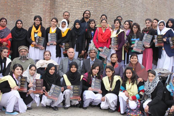 Group photo of ceramics workshop participants.