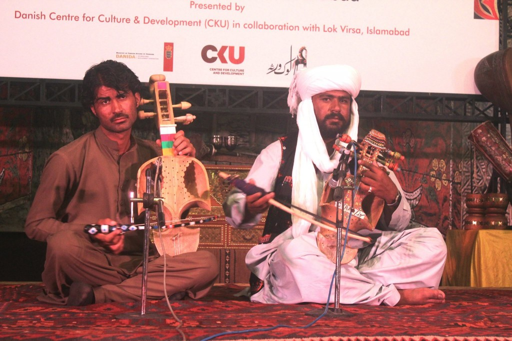 Pakistani artists performing at the launch of Cultural cooperation program between Pakistan and Denmark held in Islamabad.