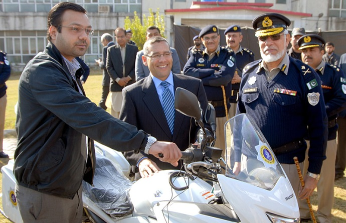 INL's Mr. Ramon Chico, Parliamentary Secretary Alam Dad Laleeka and IG National Highway and Motorway Police inspect the new bikes.