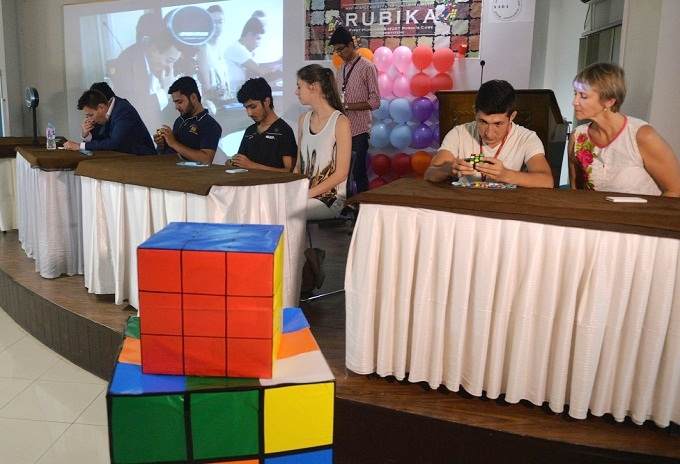 Students busy in solving Rubik's Cube at national competition held at NUST Pakistan