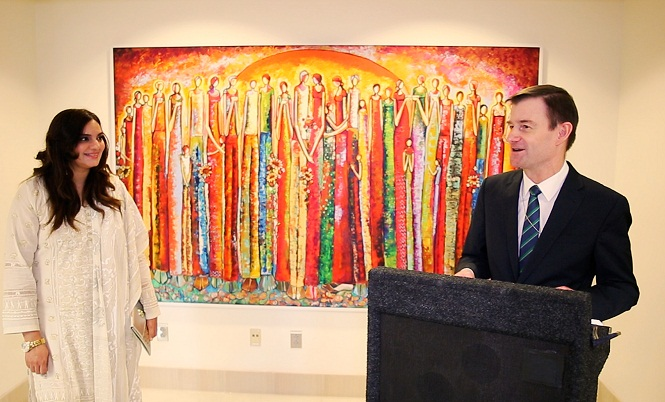 Artist Shazly Khan and American Ambassador at U.S. Embassy with Shazly Khan mural in the background