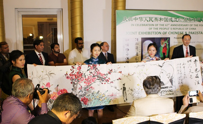 Chinese artists presenting their artwork at art exhibition by Pakistani and Chinese artists at PNCA in Islamabad on 18 Oct. 2016.