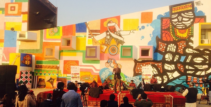 U.S. Embassy Acting Minister Counselor for Public Affairs Rob Raines dedicates a mural jointly designed and painted by American and Pakistani artists at Lok Virsa.