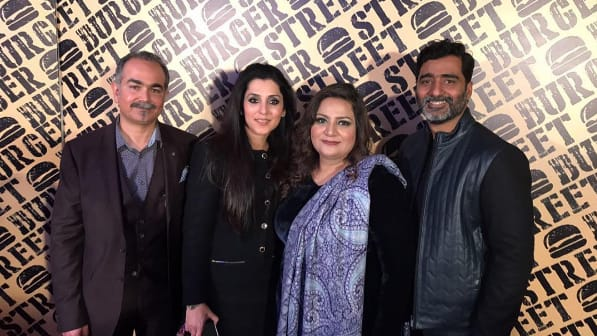 Sofia and Ali Umar Alvie with Samreen Ahsan Bhatty - owners of the Street Burger at the launch event