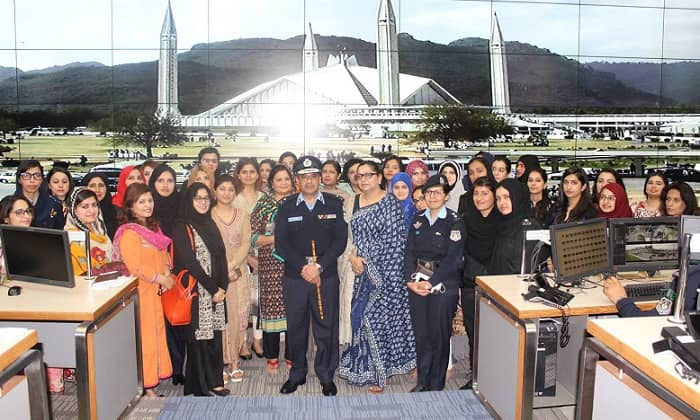 IG Police Islamabad Tariq Masood Yasin and Station Director Aisha Jamil brief women participants about Islamabad Police initiatives