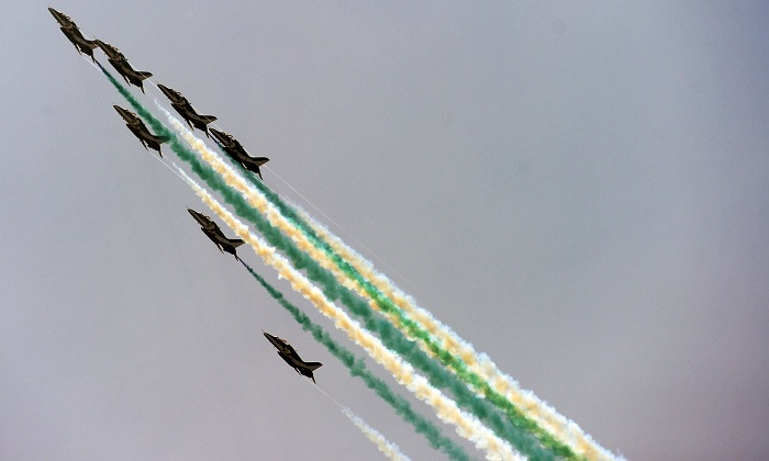 An aerobics team performs during the celebratory airshow. —AFP
