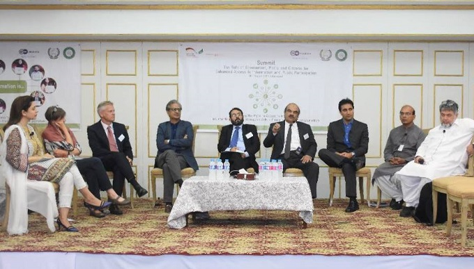 Participants discussing the Right to Information Act during a panel discussion in Islamabad