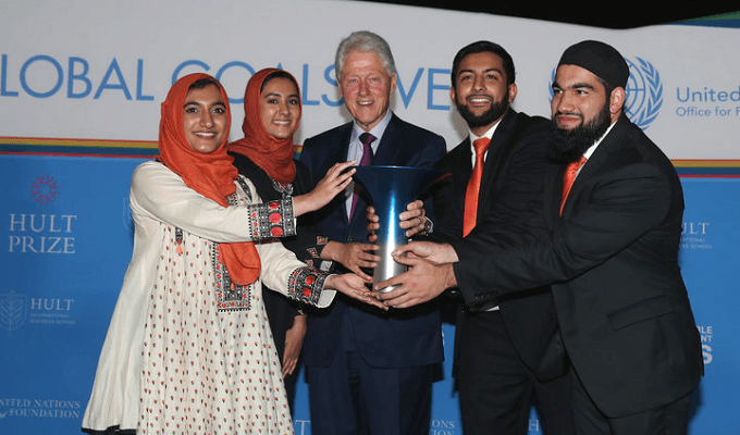 Hanaa Lakhani, Moneed Mian, Hasan Usmani, and CEO Gia Farooqi with former US President Bill Clinton. Photo: Hult Prize Foundation