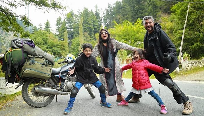 Pakistani tourist family traversing the country on single motorcycle