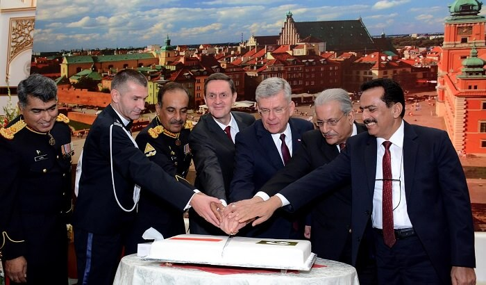 Ambassador of Poland Piotr Opalinski, Marshal of Senate of the Republic of Poland Stanislaw Karczewski, Commander 10 Corps Lieutenant General Nadeem Raza, Chairman Senate Raza Rabbani and others cutting the cake on 99th Independence Anniversary of Republic of Poland in Islamabad, Pakistan.